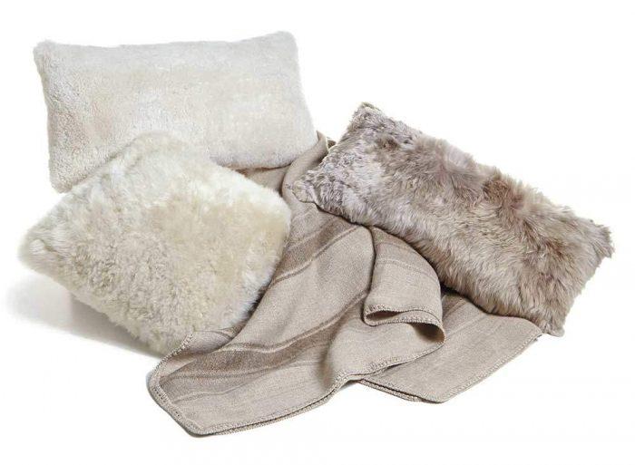 Tan throw pillows and Alpaca Throw